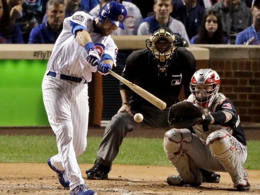Chicago Cubs second baseman Ben Zobrist hits a single during the second inning of Game 3 of the Major League Baseball World Series against the Cleveland Indians Friday, Oct. 28, 2016, in Chicago. (AP Photo/Charlie Riedel)
