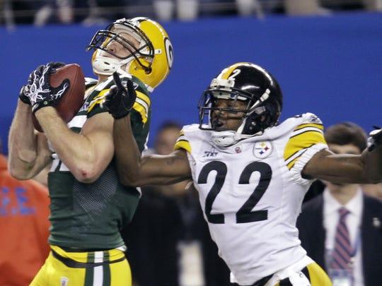 Green Bay's Jordy Nelson, left, catches a touchdown pass in front of the Steelers' William Gay (22) during the first quarter of Super Bowl XLV on Feb. 6, 2011, in Arlington, Texas.