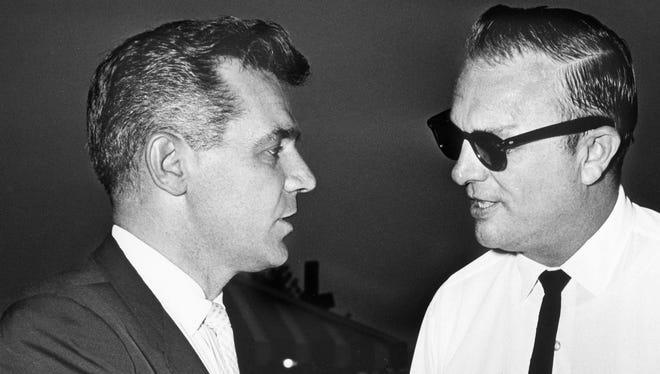 Metro Council member Sherman Hunt, center, talks with U.S. Rep. Richard Fulton, left, during Hunt's run for Davidson County sheriff in 1964.