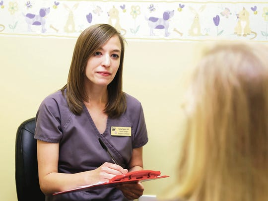 Rachel Setzer, a speech-language pathologist with Pediatrics Unlimited in Spartanburg, talks with a parent about feeding therapy options.