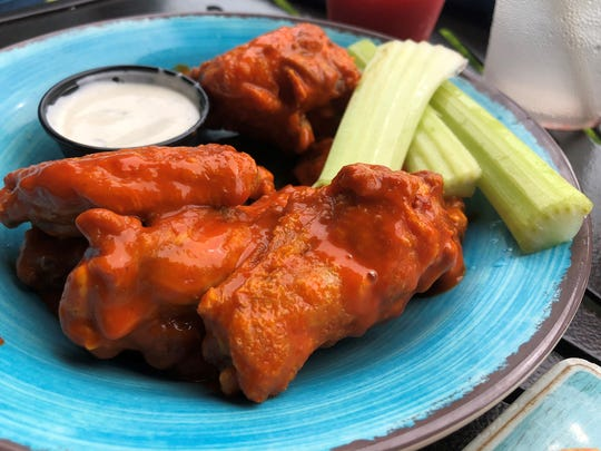 Buffalo chicken wings with celery and blue cheese dressing at Stilts Bar & Grill, Marco Island.