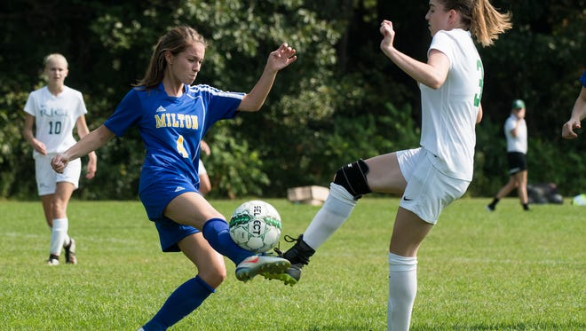 Rice's Sadie Vincent (3) and Milton's Kaleigh Goulette (4) battle for the ball during the girls soccer game between the Milton Yellow Jackets and the Rice Green Knights at Rice High School on Saturday morning September 16, 2017 in South Burlington.