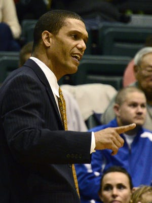 Monmouth coach King Rice communicates with his team from the bench during a game against Binghamton University in the Events Center, in Vestal, in December 2012.