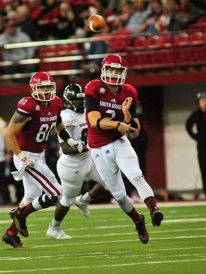 Ryan Saeger, shown here throwing a pass against Missouri State last season, is the USD incumbent starter at quarterback going into fall camp.