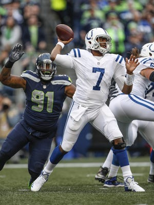 Indianapolis Colts quarterback Jacoby Brissett (7) is pressured by Seattle Seahawks defensive tackle Sheldon Richardson (91) at CenturyLink Field in Seattle on Sunday, Oct. 1, 2017.
