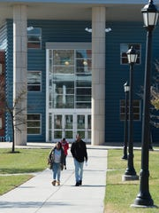 Students walk from the Wellness & Recreation Center at Delaware State University in Dover.