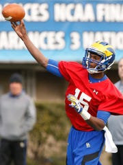 Delaware quarterback Joseph Walker throws as the University of Delaware opens its spring practice sessions at Delaware Stadium Tuesday.