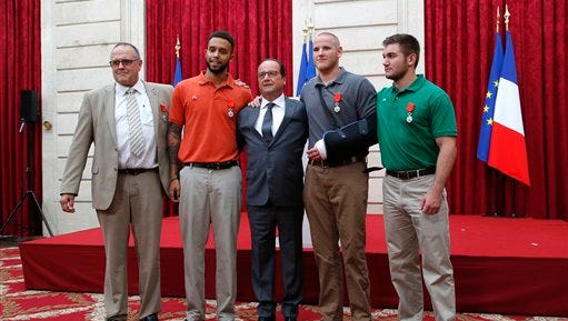 From the left, British businessman Chris Norman,  Anthony Sadler, a senior at Sacramento University in California, French President Francois Hollande, U.S. Airman Spencer Stone, and Alek Skarlatos a U.S. National Guardsman from Roseburg, Oregon pose at the Elysee Palace, Monday Aug.24, 2015 in Paris, France. Hollande  pinned the Legion of Honor medal on U.S. Airman Spencer Stone, National Guardsman Alek Skarlatos, and their years-long friend Anthony Sadler, who subdued the gunman as he moved through the train with an assault rifle strapped to his bare chest. The British businessman, Chris Norman, also jumped into the fray. (AP Photo/Michel Euler, Pool)