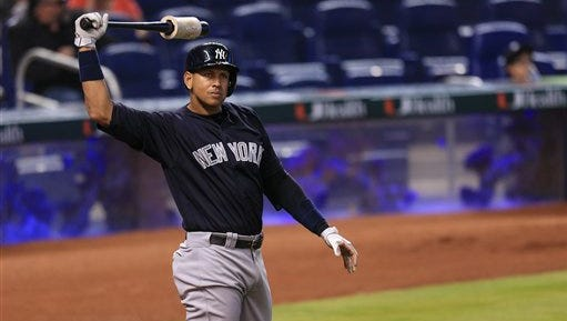 New York Yankees designated hitter Alex Rodriguez stretches before an at bat during an exhibition baseball game against the Miami Marlins on Saturday, April 2, 2016, in Miami. (AP Photo/Rob Foldy)
