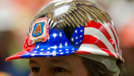 Jeff Murray, a union carpenter from Syracuse, N.Y., listens to a speaker during a Rebuild NY Now rally at the Legislative Office Building on Monday, March 21, 2016, in Albany, N.Y.