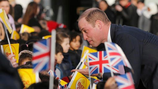 """Britain's Prince William speaks to pupils as he and Kate, The Duchess of Cambridge, arrive to attend """"The Big Assembly"""" by Place2Be hosted at Mitchell Brook Primary School in London, Monday, Feb. 6, 2017. The Big Assembly, on the theme of kindness, is one of many being held at primary schools across the UK to mark Children's Mental Health Week (Feb. 6-12)."""