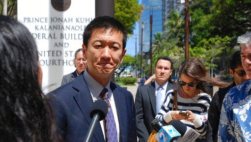 Hawaii Attorney General Douglas Chin speaks outside federal court in Honolulu, Wednesday, March 29, 2017. A federal judge in Hawaii questioned government attorneys Wednesday who urged him to narrow his order blocking President Donald Trump's travel ban because suspending the nation's refugee program has no effect on the state. U.S. District Judge Derrick Watson is hearing arguments on whether to extend his temporary order until Hawaii's lawsuit works its way through the courts. Even if he does not issue a longer-lasting hold on the ban, his temporary block would stay in place until he rules otherwise.