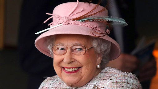 Britain's Queen Elizabeth II smiles as she attend an event at Newbury Racecourse in Newbury England Friday April 21, 2017. The Queen celebrated her 91st birthday on Friday.