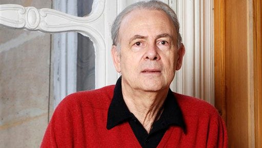 In this undated photo provided by publisher Gallimard, French novelist Patrick Modiano poses for a photograph. Patrick Modiano of France has won the 2014 Nobel Prize for Literature, it was announced Thursday.