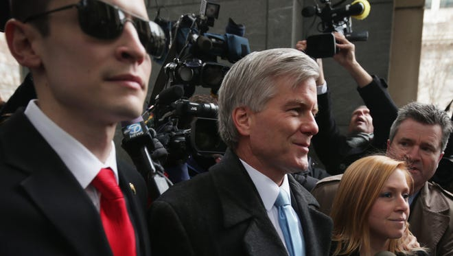 Former Virginia governor Robert McDonnell, center, arrives Jan. 6, 2014, at U.S. District Court in Richmond, Va., with his daughter Cailin Young, right, and his son-in-law Chris Young, left.