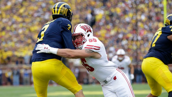 Badgers linebacker Garret Dooley tries to sack Michigan Wolverines quarterback Wilton Speight during the first quarter of a game on Oct. 1.