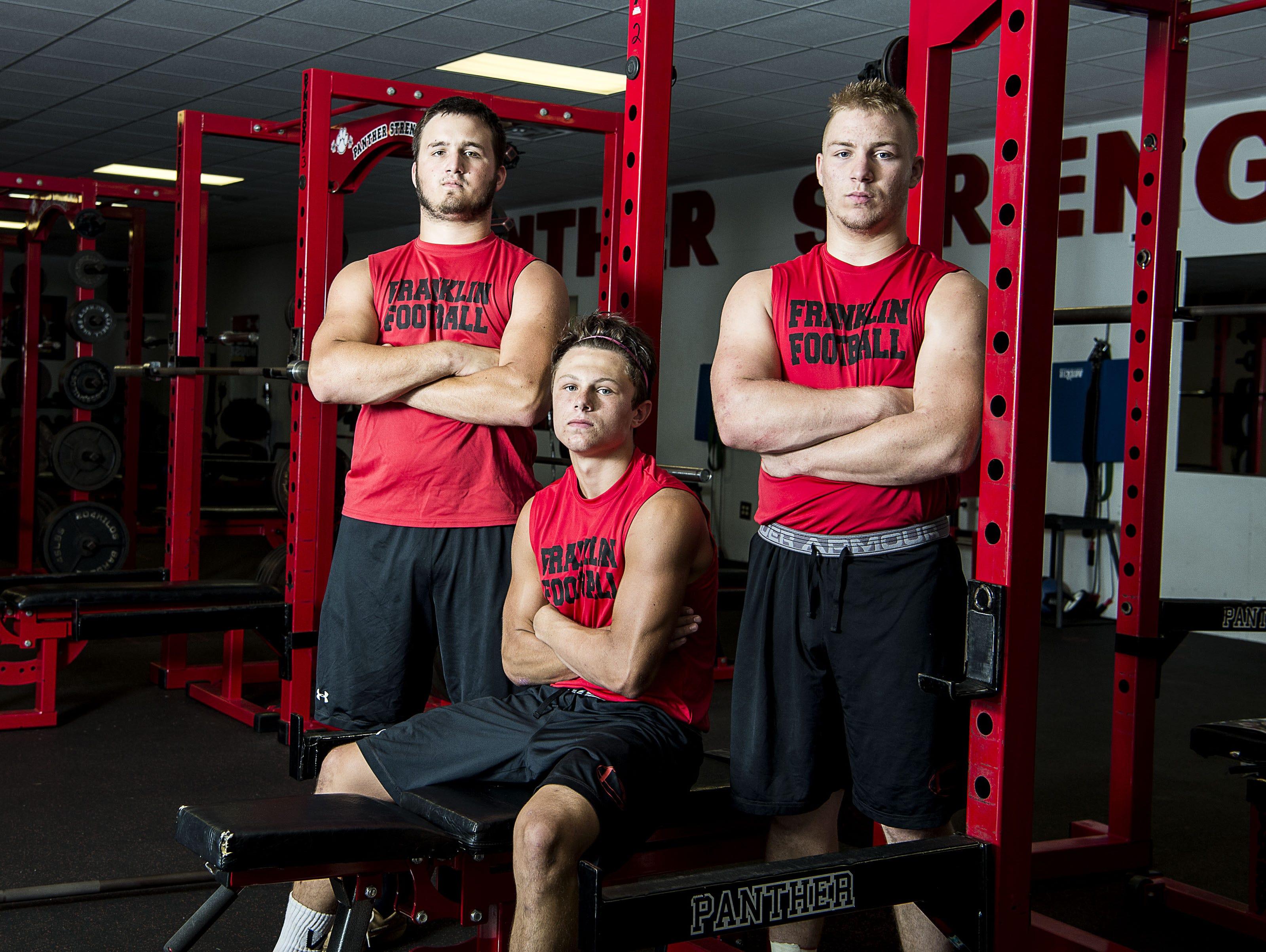 Franklin football players Dillon Daves, Logan Tallent and Jordan Nugent.