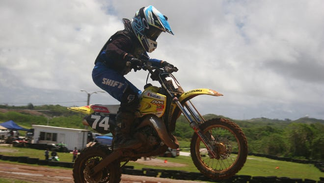 Damien Manibusan, a competitor in the 65cc minibike class, finished third during Round 4 of the Monster Energy 2015 Guam Motocross Championships on May 31. Photo courtesy of Robert Bucek