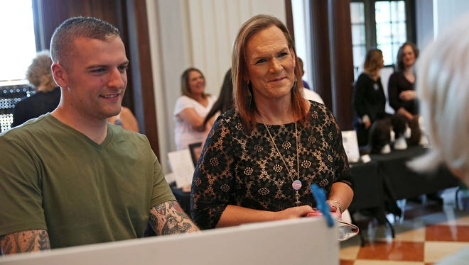 From left, Jonathan Lounds and Tara Chouinard chat with a vendor during a free transgender-focused health fair hosted by Circle City IN Pride and the Indiana Historical Society, at the historical society on Ohio Street, Wednesday, June 8, 2016. The health fair was followed by a conversation and Q&A session sponsored by the Indiana Youth Group.