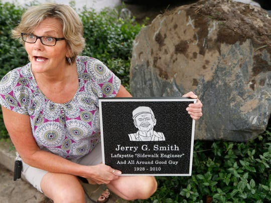 Angela Smith talks about the monument honoring her late father, Jerry Smith, Friday, June 23, 2017, in downtown Lafayette. Jerry Smith was well known for pushing a small cart and cleaning up trash throughout downtown Lafayette. He was 81 when he died in 2010. The monument to Jerry Smith will be erected on Fifth Street.