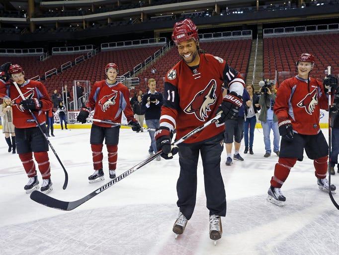 Arizona Coyotes' Christian Dvorak, Jakob Chychrun and