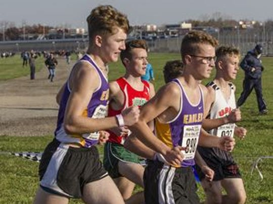 Getting off to a good start during the D4 boys cross country finals at Michigan International Speedway are PCA's Quinn McLaren and Ian Hay.