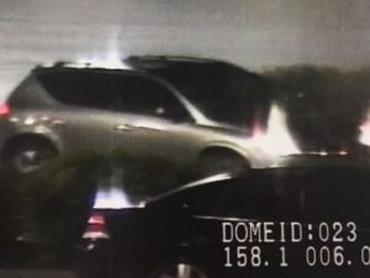Getaway vehicle: Police said the suspected Walmart shoplifter drove off in a gold Nissan Murano.