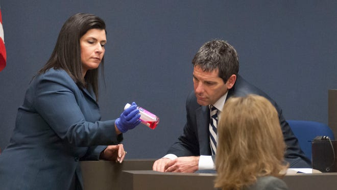 Senior Assistant Prosecutor Mona Armstrong shows Medical Examiner Dr. Daniel a bottle of Benadryl that was taken as evidence from the home of Elizabeth Long. Long is charged with second-degree murder and second-degree child abuse after investigators said her 16-month-old son died of an overdose of the active ingredient in Benadryl.
