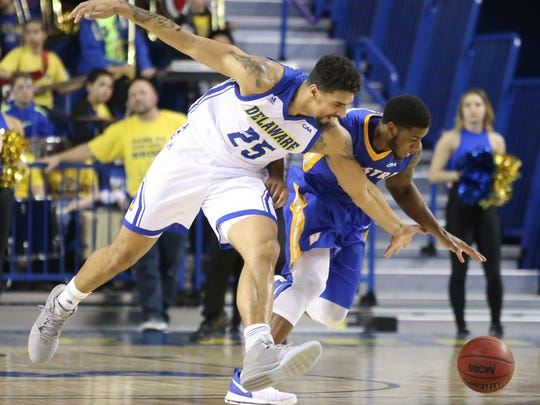 Delaware forward Skye Johnson (left) tries to pull in a loose ball against Hofstra's Justin Wright-Foreman in the first half at the Bob Carpenter Center Saturday.