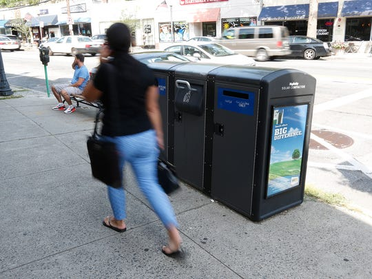 Bigbelly solar trash-recycling compactor  in  downtown