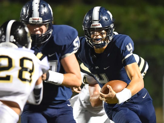 Jackson Academy quarterback Kinkead Dent (4) runs the