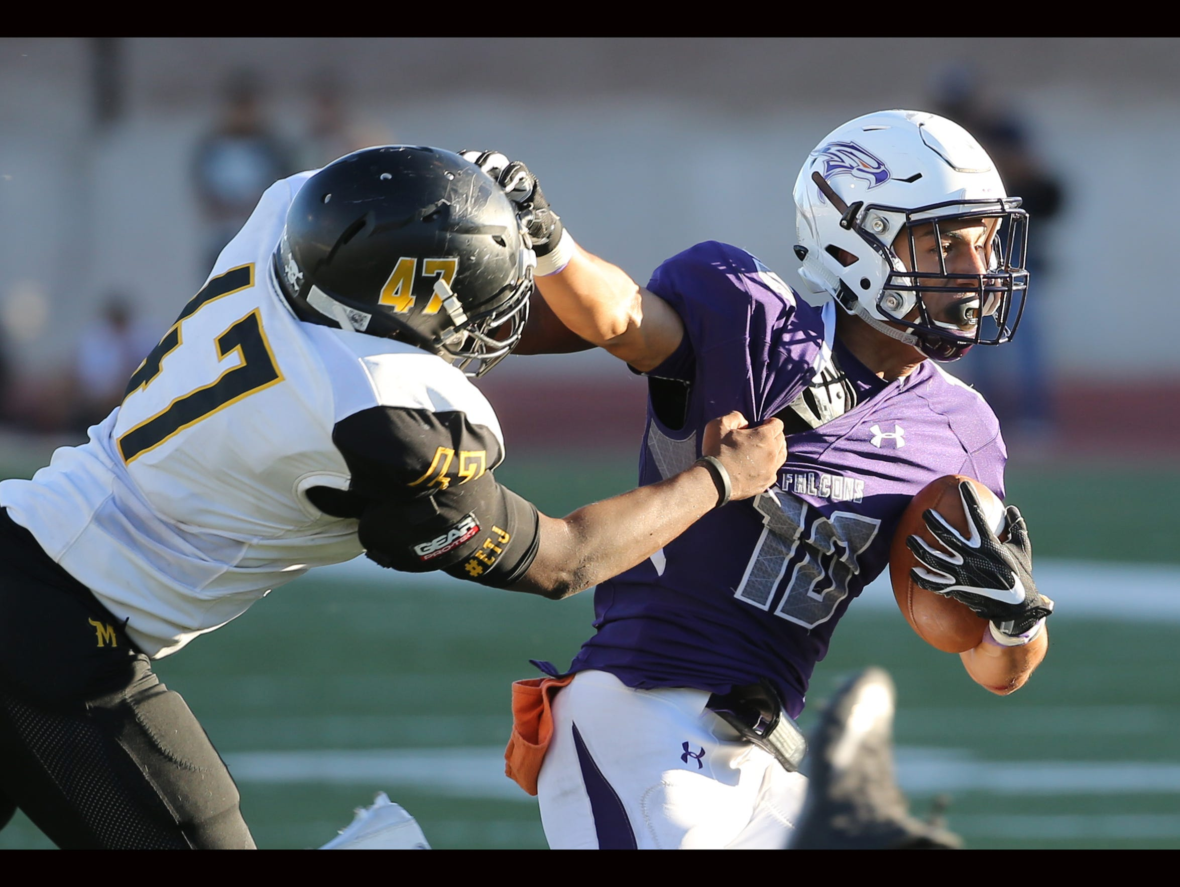 Eastlake's Isaiah Granados, right, fends off Parkland's
