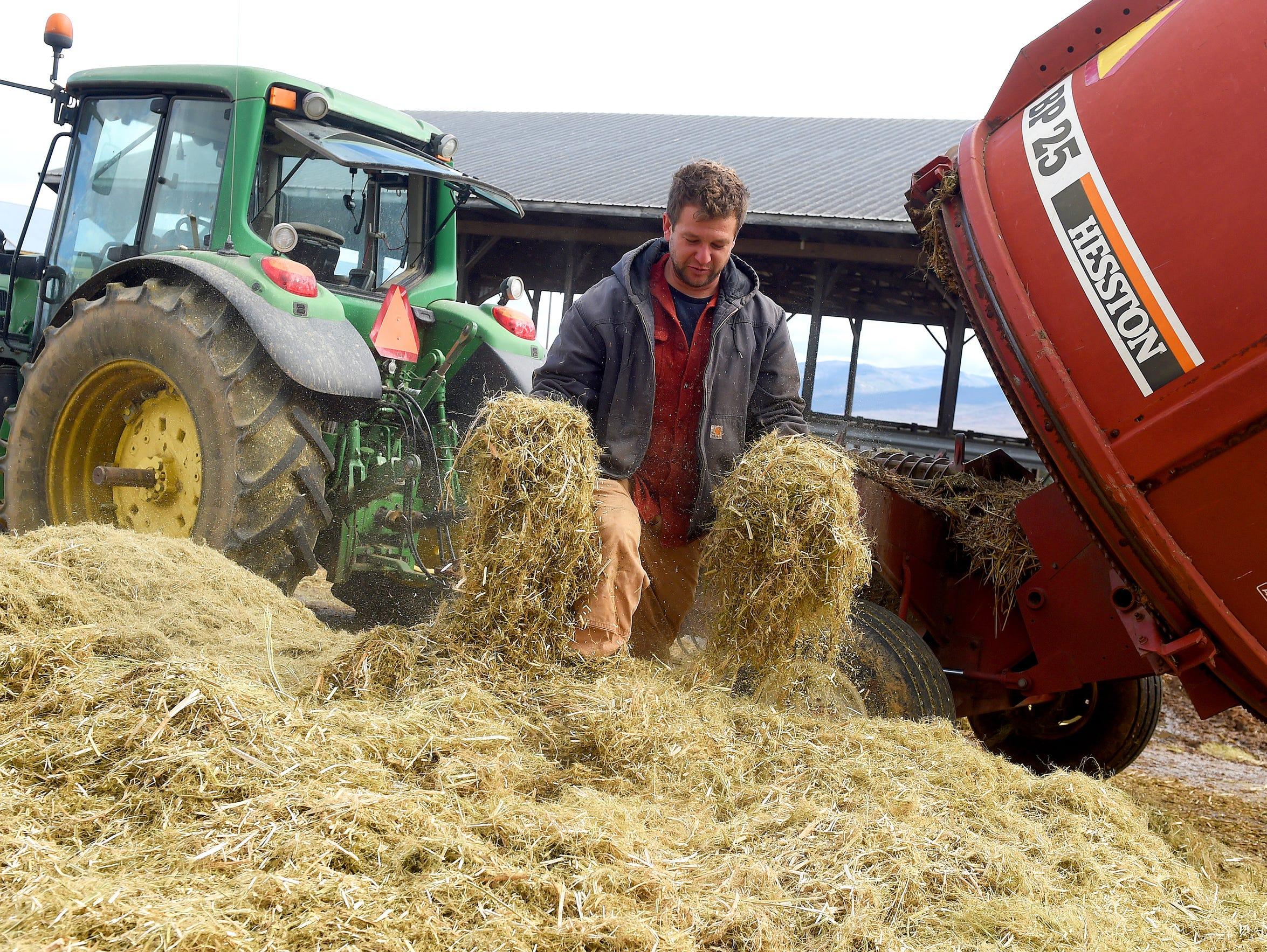 Farmer Brian Walden of Charlottesville checks the consistency