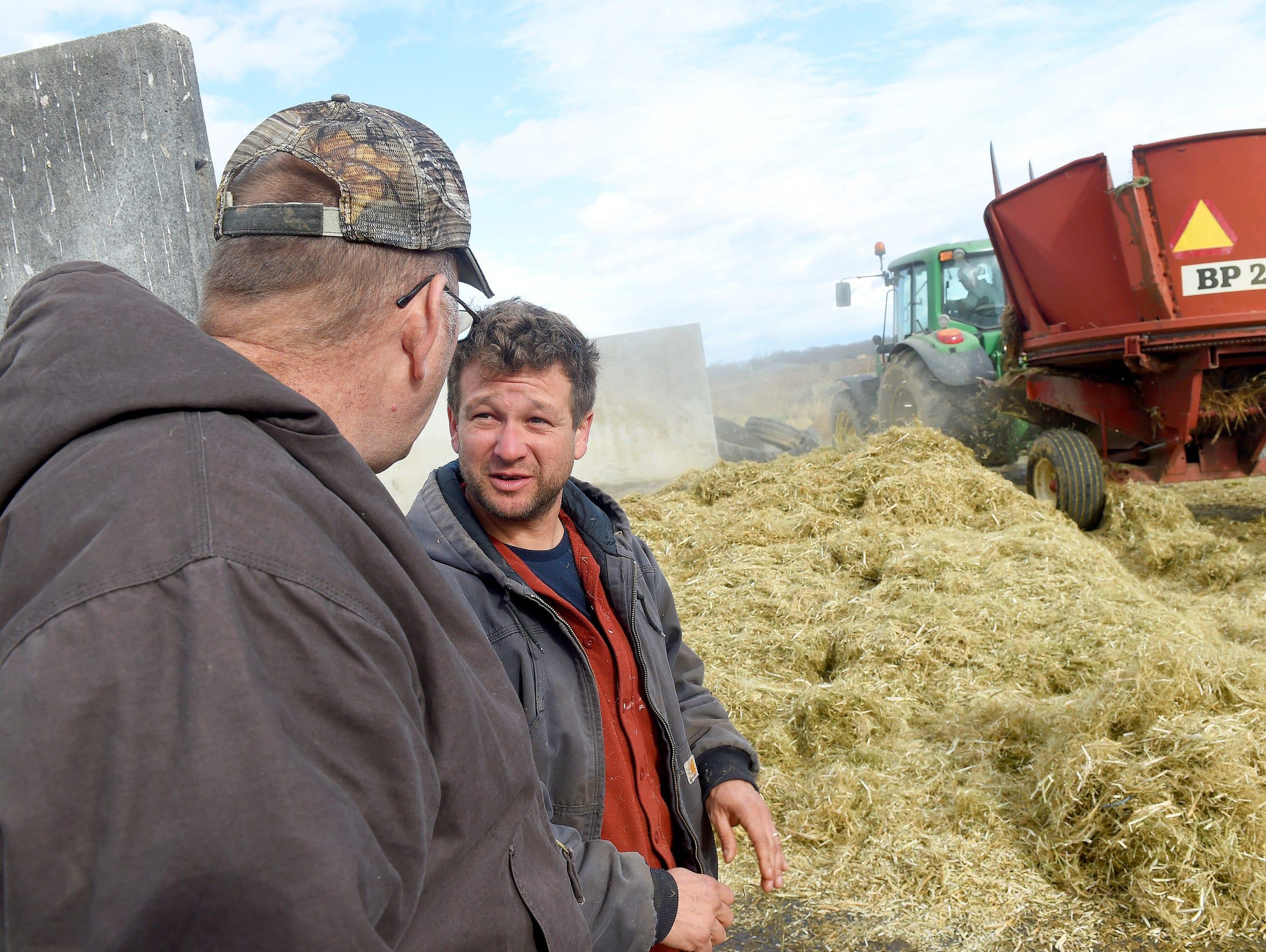 Farmer Glenn Rodes of Port Republic talks with fellow