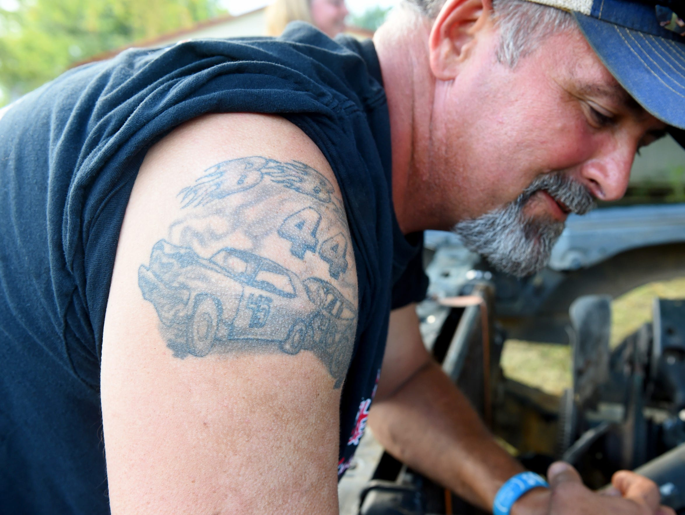 John Breeden has his father's competition number tattooed