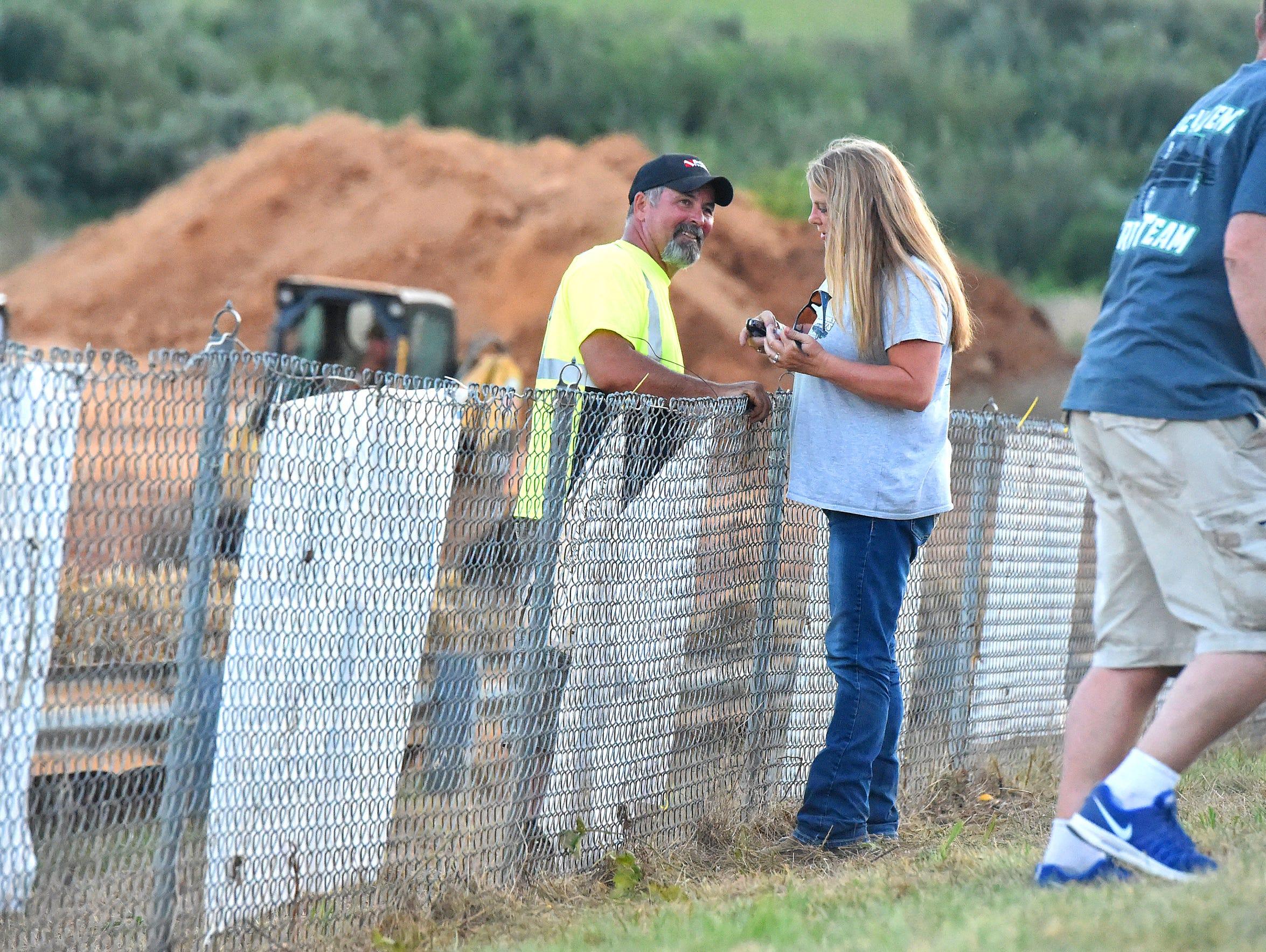 John Breeden of New Hope talks over the track fence