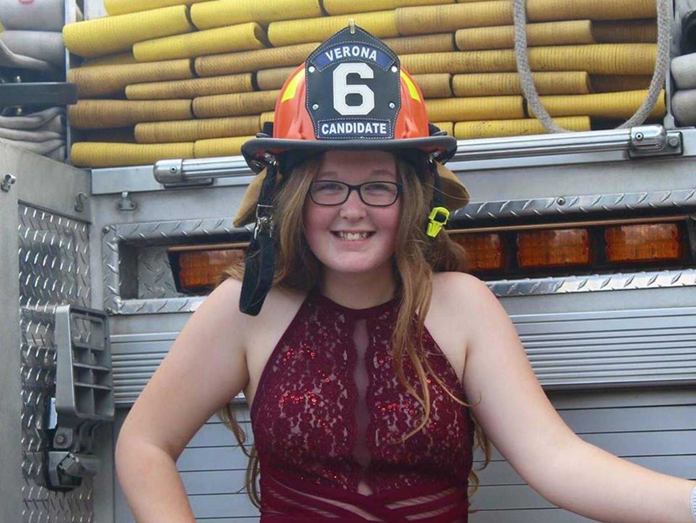 Arianna Hoover, 16, chose to have her prom photos taken down at Verona Volunteer Fire Company's firehouse where she works as a junior volunteer firefighter.
