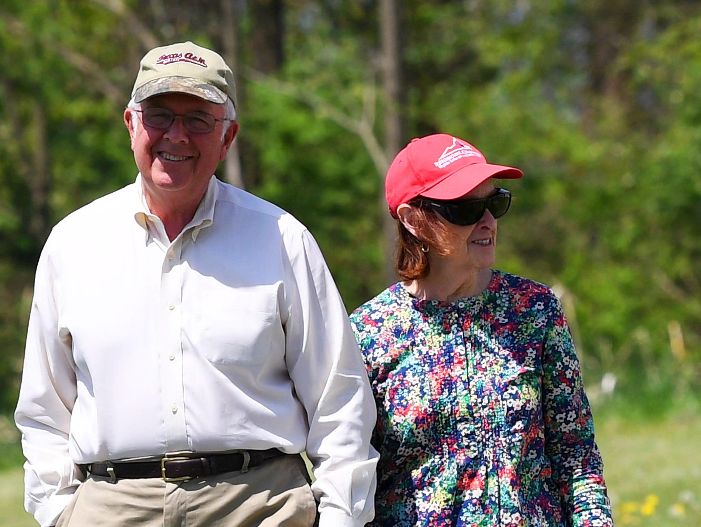 Carol Webb walks with her husband Patrick Webb on Thursday,