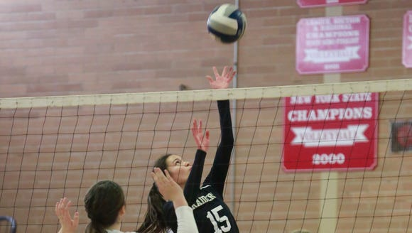 Scarsdale's volleyball player Annemarie Horn (15) returns