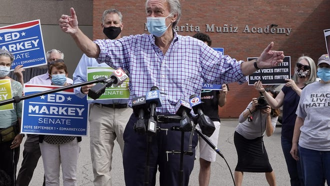 U.S. Sen. Ed Markey, D-Mass., left, is flanked by supporters as he addresses members of the media during a campaign stop, Tuesday, Sept. 1, 2020, in Boston. Markey, 73, is running in the primary against U.S. Rep. Joe Kennedy, D-Mass., for a second full term in the Senate.
