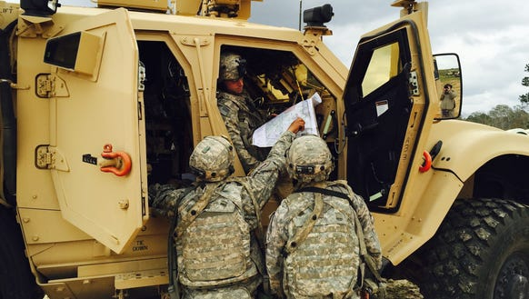 3) Soldiers from 1st Brigade look at a map of the training