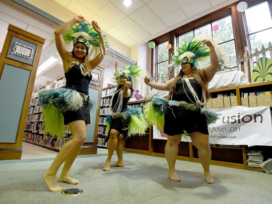 Dancers from Hula Fusion in Cleveland entertain visitors