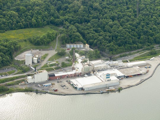 The U.S. Salt mine complex, right, sits on the shore