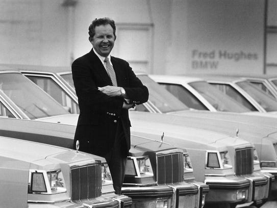 Fred Lee Hughes stands in front of his business, Fred Hughes Buick, which was located on North First Street in 1982.