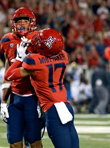 Oct 14, 2017; Tucson, AZ, USA; Arizona Wildcats defensive back Dane Cruikshank (9) and cornerback Jace Whittaker (17) and linebacker Brandon Rutt (18) celebrate after an interception during the second half against the UCLA Bruins at Arizona Stadium.