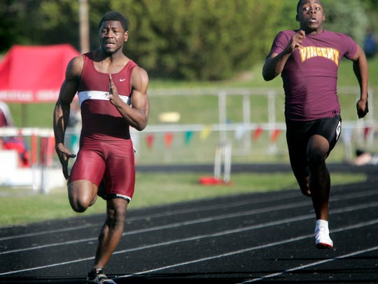 Menomonee Falls runner Washington Farrington (left) competes in the 100-meter dash on his way to a sectional title May 29, 2009.