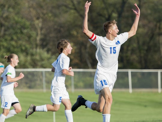 McConnellsburg's Ethan Barclay (15) celebrates after