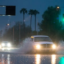 A truck drives through water on McClintock Road Sept. 8, 2014, in Tempe.