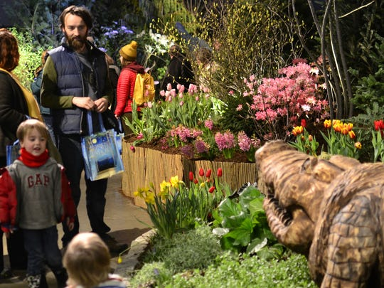 Rainier Stillson, 3, of Richmond, reacts upon seeing a crocodile statue at the Vermont Flower Show on March 5, 2017, at the Champlain Valley Exposition.