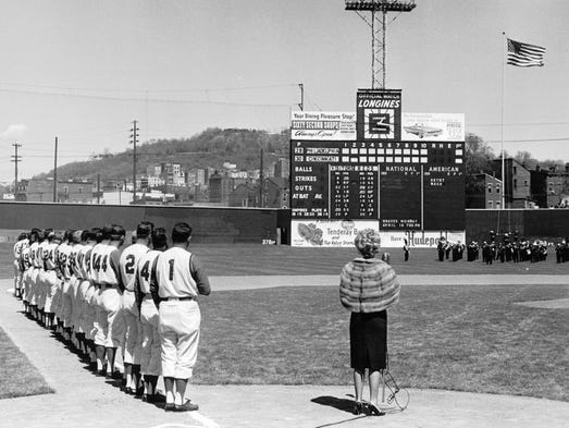 Marian Spelman sings the National Anthem prior to Opening Day 1962 at Crosley Field.